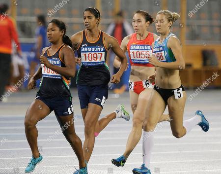 India's Swapna Barman leads compatriot Susmita Singha Roy, China's Wang Qingling and Uzbekistan's Ekaterina Voronina in women's their heptathlon 800m heat at the 17th Asian Games in Incheon, South Korea