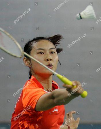 China's Wang Yihan returns the shuttlecock against Bae Yeon-ju of South Korea during their Women's Singles semifnal badminton match at the 17th Asian Games at Gyeyang Gymnasium in Incheon, South Korea