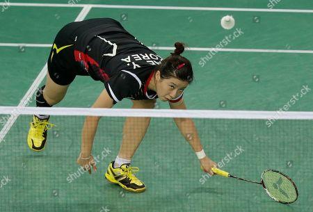 Bae Yeon-ju of South Korea competes against China's Wang Yihan during their Women's Singles semifnal badminton match at the 17th Asian Games at Gyeyang Gymnasium in Incheon, South Korea