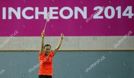 China's Wang Yihan celebrates after defeating Bae Yeon-ju of South Korea during their Women's Singles semifnal badminton match at the 17th Asian Games at Gyeyang Gymnasium in Incheon, South Korea