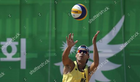 Wong Chun-wai Hong Kong's Wong Chun-wai serves the ball against South Korea's Moon Jung-hyun and Lee Hee-yoon during men's beach volleyball match at the 17th Asian Games at Songdo Global University Beach Volleyball Venue