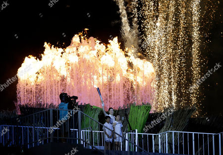 South Korean actress Lee Young-ae holds high the Asian Games flame after lighting the cauldron during the opening ceremony for the 17th Asian Games in Incheon, South Korea
