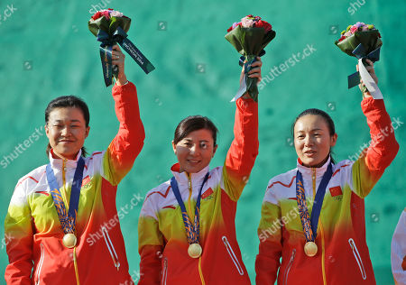 Gold Medalists, from left to right, Bai Yi Ting, Zhang Yafei, and Zhu Mei of China celebrate during the medal ceremony for the Women's Double Trap Team shooting competition at the 17th Asian Games in Incheon, South Korea