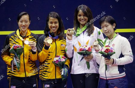 Medalists, from left to right, silver medalist Lee We Wern of Malaysia, gold medalist Nicol Ann David of Malaysia and bronze medalists India's Rebecca Pallikal Dipka and Hong Kong's Annie Au Wing Chi pose with medals during the medal ceremony for the Women's Singles squash at the 17th Asian Games in Incheon, South Korea