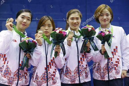 Song Sunmi, Lee Ji-hyun, Park Eun-ok, Yang Yeon-soo South Korea's Song Sunmi, left, Lee Ji-hyun, 2nd left, Park Eun-ok, 2nd right, and Yang Yeon-soo, right, pose with their bronze medals during the women's team squash award ceremony at the 17th Asian Games in Incheon, South Korea