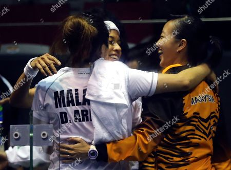Nicol David, Low Wee Wern, Delia Arnold Malaysia's Nicol David, center, with her teammates Delia Arnold, left, and Low Wee Wern, right, celebrate for their gold medal during their women's team squash final match anoints India team at the 17th Asian Games in Incheon, South Korea