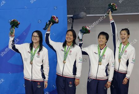 Hong Kong's women's 4 x 100-meter medley relay team, Stephanie Au, Yvette Kong, Sze Hang Yu and Siobhan Haughey hold up their bronze medals on the podium at the 17th Asian Games in Incheon, South Korea