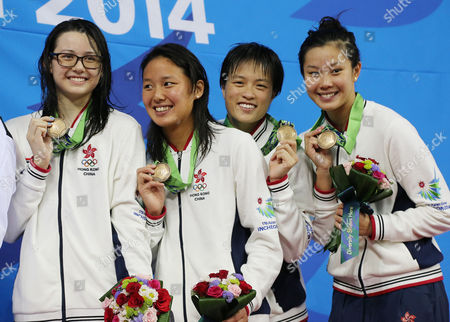 Stock Photo of Hong Kong's women's 4 x 100-meter medley relay team, Stephanie Au, Yvette Kong, Sze Hang Yu and Siobhan Haughey hold up their bronze medals on the podium at the 17th Asian Games in Incheon, South Korea