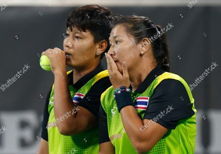 Stock Picture of Luksika Kumkhum,Tamarine Tanasugarn Thailand's Luksika Kumkhum, left, chats with Tamarine Tanasugarn during the women's doubles gold medal tennis match against Taiwan's Chan Chin Wei and Hsieh Su Wei at the 17th Asian Games in Incheon, South Korea