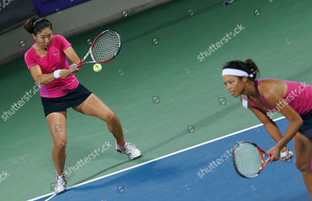 Chan Chin Wei, Hsieh Su Wei Taiwan's Chan Chin Wei, left, and Hsieh Su Wei return a shot to Thailand's Luksika Kumkhum and Tamarine Tanasugarn during the women's doubles gold medal tennis match at the 17th Asian Games in Incheon, South Korea