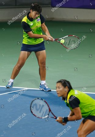 Luksika Kumkhum and Tamarine Tanasugarn, Chan Chin Wei, Hsieh Su Wei Thailand's Luksika Kumkhum, top and Tamarine Tanasugarn return a shot to Taiwan's Chan Chin Wei and Hsieh Su Wei during the women's doubles gold medal tennis match at the 17th Asian Games in Incheon, South Korea