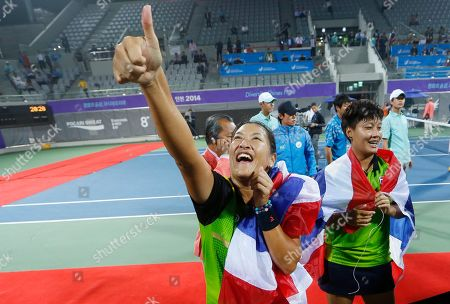 Luksika Kumkhum, Tamarine Tanasugarn Thailand's Luksika Kumkhum, right, and Tamarine Tanasugarn celebrate after winning the women's doubles gold medal tennis match at the 17th Asian Games in Incheon, South Korea