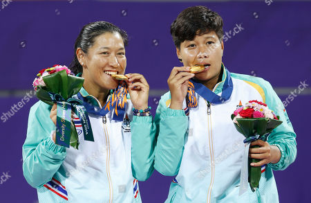 Luksika Kumkhum, Tamarine Tanasugarn Gold medal winners Thailand's Luksika Kumkhum, right, and Tamarine Tanasugarn celebrate after winning the women's doubles tennis match at the 17th Asian Games in Incheon, South Korea