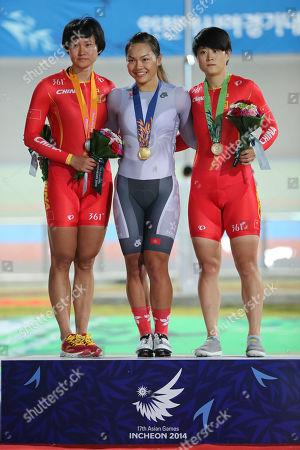 Zhong Tianshi, Lee Wai Sze, Lin Junhong Medalists left to right; China's Zhong Tianshi, Hong Kong Lee Wai Sze, gold, and China's Lin Junhong, bronze, pose after the women's sprint track cycling race at the 17th Asian Games in Incheon, South Korea