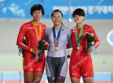 Medalists left to right; China's Zhong Tianshi, Hong Kong Lee Wai Sze, gold, and China's Lin Junhong, bronze, pose after the women's sprint track cycling race at the 17th Asian Games in Incheon, South Korea