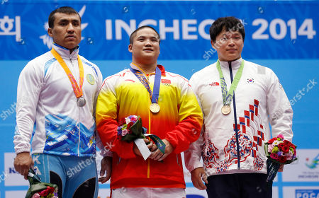 Almas Uteshov, Liu Hao, Lee Chang-ho From left, silver medal winner Kazakhstan's Almas Uteshov, gold medal winner China's Liu Hao and bronze medal winner South Korea's Lee Chang-ho celebrate after winning the men's 94kg weightlifting competition at the 17th Asian Games in Incheon, South Korea