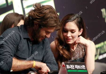 """Megan Fox, Jonathan Liebesman Megan Fox, right, talks with director Jonathan Liebesman at a press conference for their latest film """"Teenage Mutant Ninja Turtles"""" in Seoul, South Korea, . The movie will be released in South Korea on Aug. 28"""