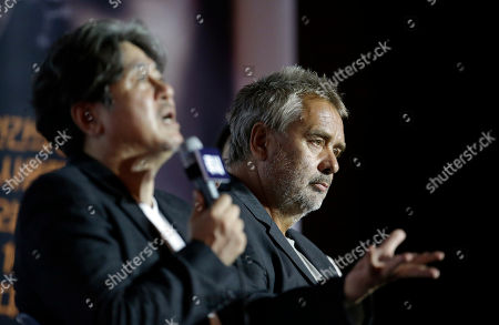 "Luc Besson, Choi Min-sik French director Luc Besson, right, listens as South Korean actor Choi Min-sik, left, speaks during a press conference for their new movie ""Lucy"" in Seoul, South Korea, . The movie is to be released in South Korea on Sept. 4"