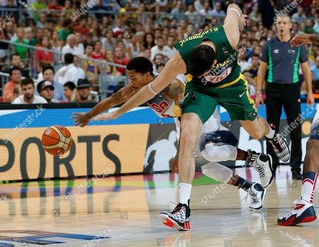 Derrick Rose, Darjus Lavrinovic United States's Derrick Rose, left, and Lithuania's Darjus Lavrinovic go for the ball during their Basketball World Cup semifinal match at the Palau Sant Jordi in Barcelona, Spain