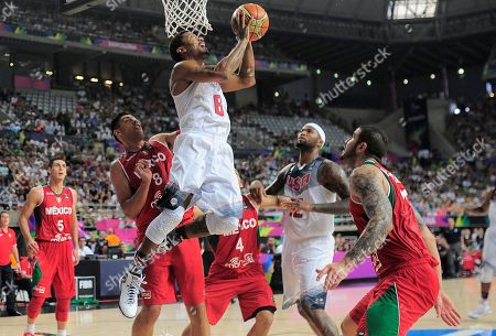 Derrick Rose, Gustavo Ayon Derrick Rose of the U.S, third left, shoots over Mexico's Gustavo Ayon, second left, during Basketball World Cup Round of 16 match between United States and Mexico at the Palau Sant Jordi in Barcelona, Spain, . The 2014 Basketball World Cup competition will take place in various cities in Spain from Aug. 30 through to Sept. 14
