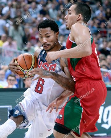 Paul Stoll, Derrick Rose Derrick Rose of the U.S, left, vies for the ball over Mexico's Paul Stoll during Basketball World Cup Round of 16 match between United States and Mexico at the Palau Sant Jordi in Barcelona, Spain, . The 2014 Basketball World Cup competition will take place in various cities in Spain from Aug. 30 through to Sept. 14
