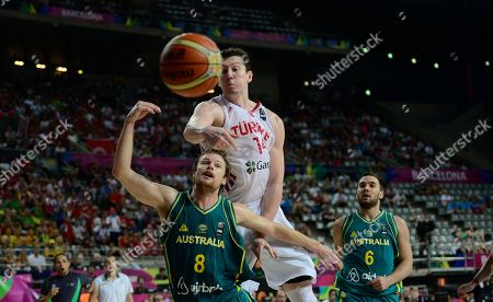 Omer Asik, Brad Newley Turkey's Omer Asik, second right, vies for the ball against Australia's Brad Newley during Basketball World Cup Round of 16 match between Turkey and Australia at the Palau Sant Jordi in Barcelona, Spain, . The 2014 Basketball World Cup competition will take place in various cities in Spain from Aug. 30 through to Sept. 14