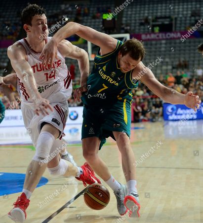 Omer Asik, Joe Ingles Turkey's Omer Asik, left, vies for the ball against Australia's Joe Ingles during Basketball World Cup Round of 16 match between Turkey and Australia at the Palau Sant Jordi in Barcelona, Spain, . The 2014 Basketball World Cup competition will take place in various cities in Spain from Aug. 30 through to Sept. 14