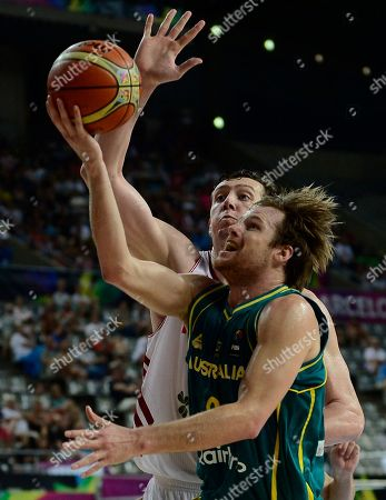 Omer Asik, Brad Newley Turkey's Omer Asik, left, vies for the ball against Australia's Brad Newley during Basketball World Cup Round of 16 match between Turkey and Australia at the Palau Sant Jordi in Barcelona, Spain, . The 2014 Basketball World Cup competition will take place in various cities in Spain from Aug. 30 through to Sept. 14
