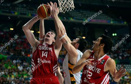 Ksistof Lavrinovic, Omer Asik, Kerem Gonlum Turkey's Omer Asik, left, and Kerem Gonlum, right, vie for the ball with Lithuania's Ksistof Lavrinovic during their Basketball World Cup quarterfinal match at the Palau Sant Jordi in Barcelona, Spain, . The 2014 Basketball World Cup competition will take place in various cities in Spain from Aug. 30 through to Sept. 14