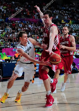 Omer Asik, Renaldas Seibutis Turkey's Omer Asik, right, vies for the ball against Lithuania's Renaldas Seibutis during Basketball World Cup quarter finals between Lithuania and Turkey at the Palau Sant Jordi in Barcelona, Spain, . The 2014 Basketball World Cup competition will take place in various cities in Spain from Aug. 30 through to Sept. 14