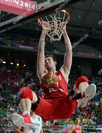 Omer Asik Turkey's Omer Asik dunks during the Basketball World Cup quarterfinal match against Lithuania at the Palau Sant Jordi in Barcelona, Spain, . The 2014 Basketball World Cup competition will take place in various cities in Spain from Aug. 30 through to Sept. 14