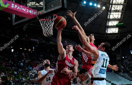 Omer Asik, Donatas Motiejunas Turkey's Omer Asik, second left, vies for the ball against Lithuania's Donatas Motiejunas, right, during Basketball World Cup quarter finals between Lithuania and Turkey at the Palau Sant Jordi in Barcelona, Spain, . The 2014 Basketball World Cup competition will take place in various cities in Spain from Aug. 30 through to Sept. 14