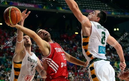 Omer Asik, Darjus Lavrinovic, Jonas Maciulis Turkey's Ender Arslan, center, vies for the ball with Lithuania's Darjus Lavrinovic, left, and Jonas Maciulis during their Basketball World Cup quarterfinal match at the Palau Sant Jordi in Barcelona, Spain, . The 2014 Basketball World Cup competition will take place in various cities in Spain from Aug. 30 through to Sept. 14