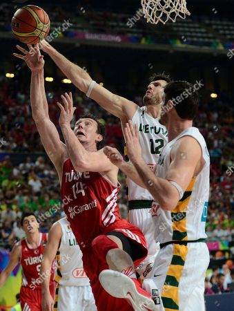 Omer Asik, Ksistof Lavrinovic Turkey's Omer Asik, left, vies for the ball with Lithuania's Ksistof Lavrinovic, center, during their Basketball World Cup quarterfinal match at the Palau Sant Jordi in Barcelona, Spain, . The 2014 Basketball World Cup competition will take place in various cities in Spain from Aug. 30 through to Sept. 14