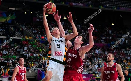 Renaldas Seibutis, Omer Asik Turkey's Omer Asik, second right, vies for the ball against Lithuania's Renaldas Seibutis, second left, during Basketball World Cup quarter finals between Lithuania and Turkey at the Palau Sant Jordi in Barcelona, Spain, . The 2014 Basketball World Cup competition will take place in various cities in Spain from Aug. 30 through to Sept. 14