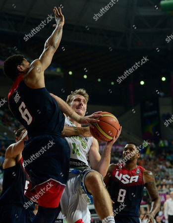 Derrick Rose, Zoran Dragic Derrick Rose the U.S, left, vies for the ball with Slovenia's Zoran Dragic during their Basketball World Cup quarterfinal at the Palau Sant Jordi in Barcelona, Spain, . The 2014 Basketball World Cup competition will take place in various cities in Spain from Aug. 30 through to Sept. 14