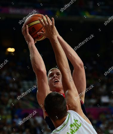 Mason Plumlee, Jure Balazic Mason Plumlee of the U.S, top, vies for the ball with Slovenia's Jure Balazic during Basketball World Cup quarterfinal between Slovenia and United States at the Palau Sant Jordi in Barcelona, Spain, . The 2014 Basketball World Cup competition will take place in various cities in Spain from Aug. 30 through to Sept. 14