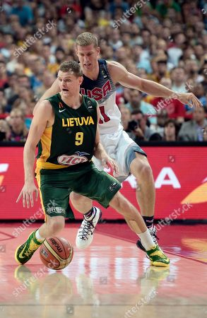Lithuania's Renaldas Seibutis, foreground, and United States's Mason Plumlee go for the ball during the Basketball World Cup semifinal match at the Palau Sant Jordi in Barcelona, Spain, . The 2014 Basketball World Cup competition will take place in various cities in Spain from Aug. 30 through Sept. 14