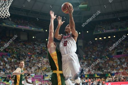 United States' Derrick Rose goes up for a basket during their Basketball World Cup semifinal match against Lithuania at the Palau Sant Jordi in Barcelona, Spain, . The 2014 Basketball World Cup competition will take place in various cities in Spain from Aug. 30 through Sept. 14