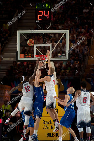 DeMarcus Cousins, Mason Plumlee United States's DeMarcus Cousins, left, and Mason Plumlee, center, duel for the ball on Finland's team ring during their match at the Basketball World Cup in Bilbao, northern Spain