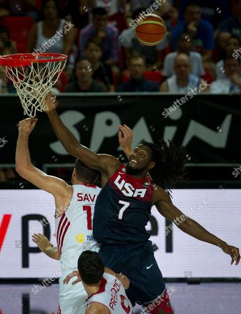 Kenneth Faried, Omer Asik United States's Kenneth Faried, right, duels for the ball in Turkey's Omer Asik, during the Group C Basketball World Cup match, in Bilbao northern Spain, . The 2014 Basketball World Cup competition take place in various cities in Spain from last Aug. 30 through to Sept. 14