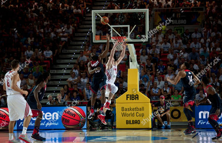 James Harden, Omer Asik United States's James Harden, center left, jumps for the ball in front of Turkey's Omer Asik, during their Group C Basketball World Cup match in Bilbao, northern Spain