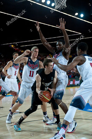 Thomas Abercrombie, Mason Plumlee, Kenneth Faried, DeMar Derozan New Zealand's Thomas Abercrombie, center, controls the ball between Mason Plumlee, Kenneth Faried, and DeMar Derozan, left to right, of the U.S during the Group C Basketball World Cup match, in Bilbao northern Spain, . The 2014 Basketball World Cup competition take place in various cities in Spain from last Aug. 30 through to Sept. 14