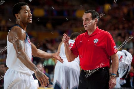 Mike Krzyzewski, Derrick Rose Unites States's coach Mike Krzyzewski, gives instructions beside US player Derrick Rose, during the Group C Basketball World Cup match between United States and New Zealand, in Bilbao northern Spain, . The 2014 Basketball World Cup competition take place in various cities in Spain from Aug. 30 through to Sept. 14. United States won 98-71