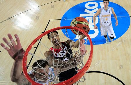Derrick Rose United States's Derrick Rose, center, shoots to the basket during the Group C Basketball World Cup match against Ukraine, in Bilbao northern Spain, . The 2014 Basketball World Cup competition take place in various cities in Spain from Aug. 30 through to Sept. 14