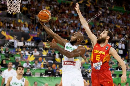 Larry Taylor, Sergio Rodriguez Brazil's Larry Taylor, left, shoots over Spain's Sergio Rodriguez during the Group A Basketball World Cup match between Brazil and Spain in Granada, Spain, . The 2014 Basketball World Cup competition will take place in various cities in Spain from Aug. 30 through to Sept. 14