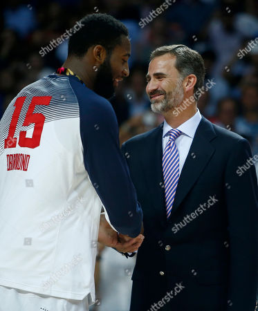 Andre Drummond, King Felipe United States' Andre Drummond, left, shakes hands with Spain's King Felipe after winning the final World Basketball match between the United States and Serbia at the Palacio de los Deportes stadium in Madrid, Spain