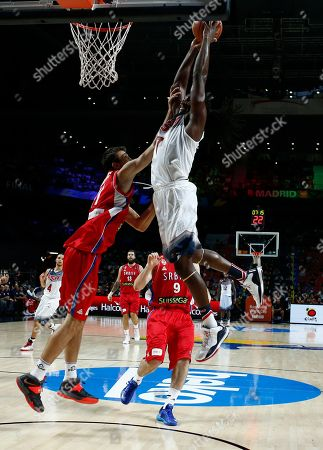 Kenneth Faried United States' Kenneth Faried, right, pushes the ball upto the basket during the final World Basketball match between the United States and Serbia at the Palacio de los Deportes stadium in Madrid, Spain