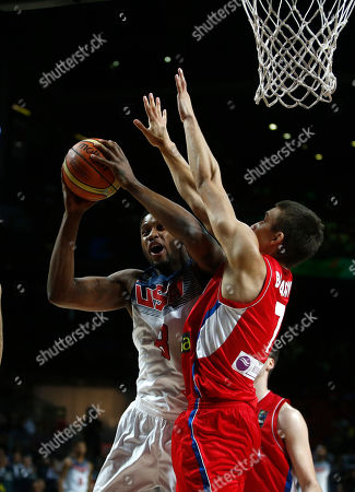 Bogdan Bogdanovic, Rudy Gay Serbia's Bogdan Bogdanovic, right tries to block United States' Rudy Gay as he pushes the ball up to the basket during the final World Basketball match between the United States and Serbia at the Palacio de los Deportes stadium in Madrid, Spain