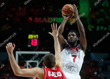 Kenneth Faried United States' Kenneth Faried, right, tries a jump shot during the final World Basketball match between the United States and Serbia at the Palacio de los Deportes stadium in Madrid, Spain